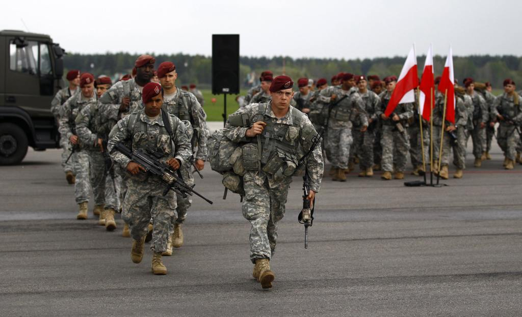 U.S. paratroopers from the U.S. Army's 173rd Infantry Brigade Combat Team based in Italy walk after unpacking as they arrive to participate in training exercises with the Polish army in Swidwin