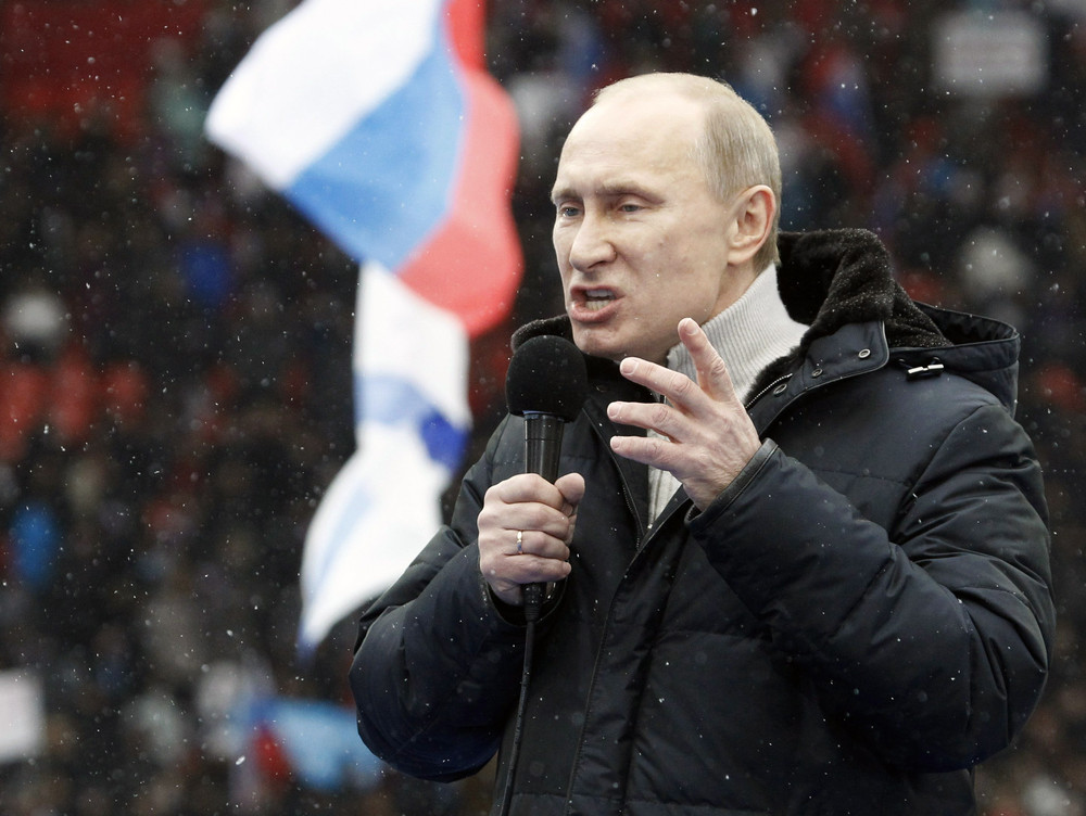 Presidential candidate and Russia's current PM Putin delivers a speech during a rally to support his candidature at the Luzhniki stadium in Moscow
