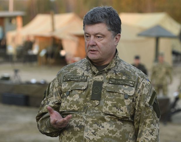 Handout photo shows Ukrainian President Poroshenko speaking at a military base as he inspects equipment, outfits and weapons near Zhytomyr