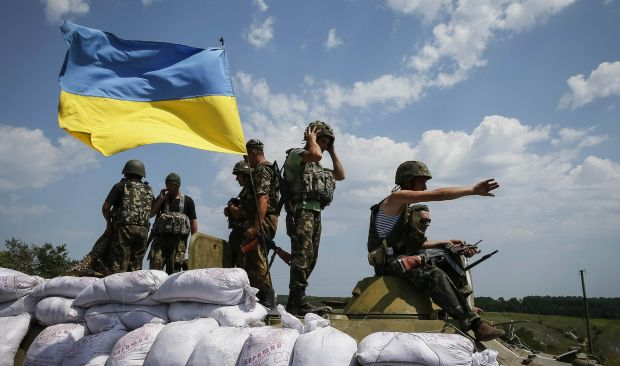 "Ukrainian troops are pictured near the eastern Ukrainian town of Seversk July 12, 2014. Ukrainian war planes bombarded separatists along a broad front on Saturday, inflicting huge losses, Kiev said, after President Petro Poroshenko said ""scores and hundreds"" would be made to pay for a deadly missile attack on Ukrainian forces.  REUTERS/Gleb Garanich  (UKRAINE - Tags: POLITICS CIVIL UNREST MILITARY TPX IMAGES OF THE DAY)"