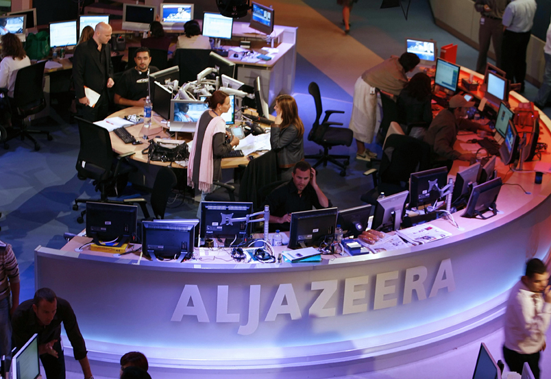 Doha, QATAR:  A general view shows the newsroom at the headquarters of the Qatar-based Al-Jazeera satellite channel in Doha 14 November 2006. The English-language version of Al-Jazeera's launches 15 November 2006 after a year-long delay. The pan-Arab TV station is out to capitalise on the strategic importance of London as a European capital when it kicks off its English-language service tomorrow. AFP PHOTO/KARIM JAAFAR  (Photo credit should read KARIM JAAFAR/AFP/Getty Images)