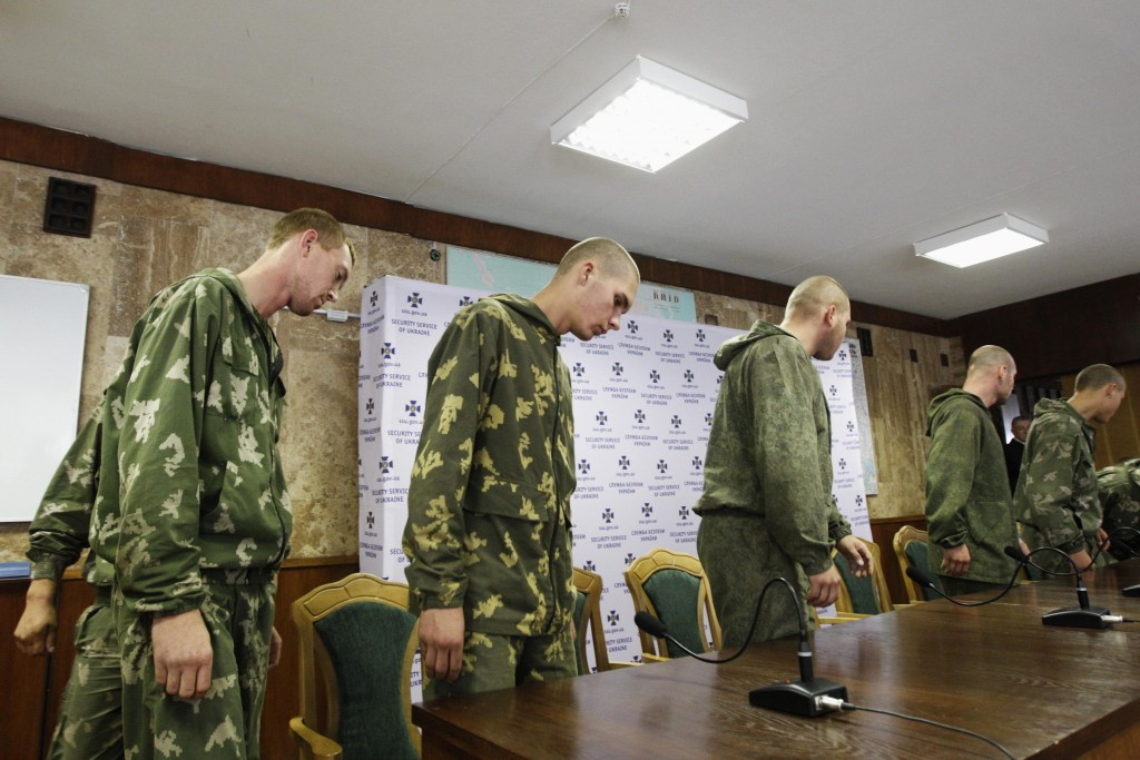 "A group of Russian servicemen, who are detained by Ukrainian authorities, arrive at a news conference in Kiev August 27, 2014. Ukraine said on Tuesday its forces had captured a group of Russian paratroopers who had crossed into Ukrainian territory on a ""special mission"" - but Moscow said they had ended up there by mistake. REUTERS/Valentyn Ogirenko (UKRAINE - Tags: MILITARY POLITICS CIVIL UNREST CONFLICT)"