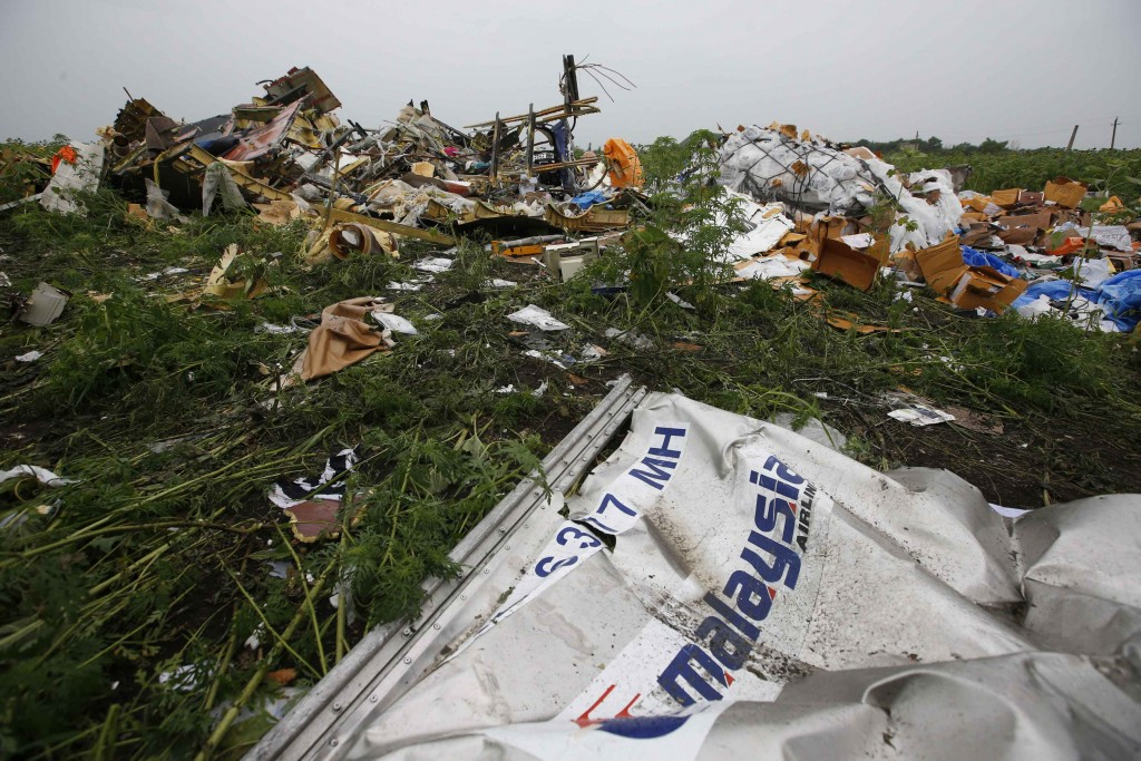 Wreckage from the nose section of a Malaysian Airlines Boeing 777 plane which was downed on Thursday is seen near the village of Rozsypne, in the Donetsk region July 18, 2014. World leaders demanded an international investigation into the shooting down of Malaysia Airlines Flight MH17 with 298 people on board over eastern Ukraine in a tragedy that could mark a pivotal moment in the worst crisis between Russia and the West since the Cold War.  REUTERS/Maxim Zmeyev (UKRAINE - Tags: POLITICS TRANSPORT DISASTER CIVIL UNREST)