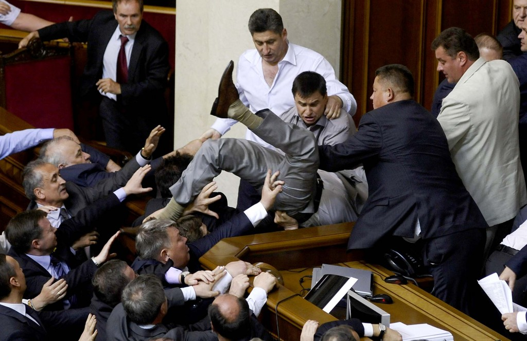 MAY 24: Lawmakers from pro-presidential and oppositional factions  in the parliament session hall in Kiev, Ukraine. The violent scuffle erupted over a bill that would allow the use of the Russian language in courts, hospitals and other institutions in the Russian-speaking regions of the country. (Maks Levin/Associated Press)