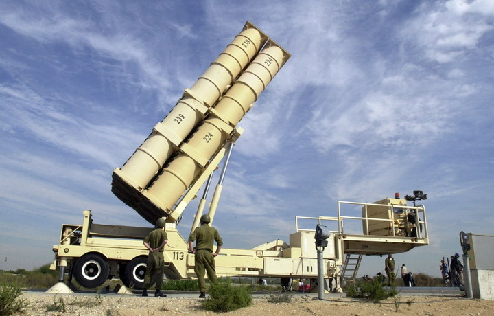 Israeli soldiers demonstrate the operation of the Arrow anti-missile mobile launcher at the Palmachim army base in central Israel Thursday,  Nov. 7, 2002. The anti-missile batteries were shown to reporters as part of a public relations blitz aimed at discouraging Saddam Hussein from firing his Scuds. (AP Photo/Eitan Hess-Ashkenazi)
