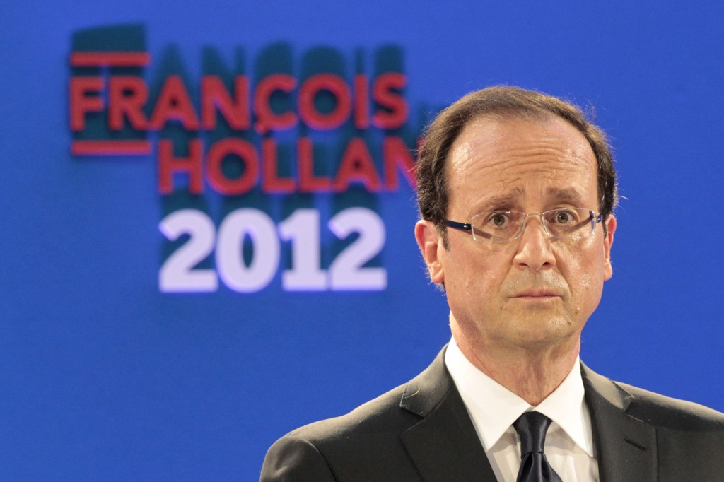 Francois Hollande, Socialist Party candidate for the 2012 French presidential election, delivers a speech in Paris January 26, 2012. Hollande said he will raise taxes on the rich, cut tax on profits for smallest firms and cancel billions of euros of tax breaks. REUTERS/Charles Platiau (FRANCE - Tags: POLITICS ELECTIONS)