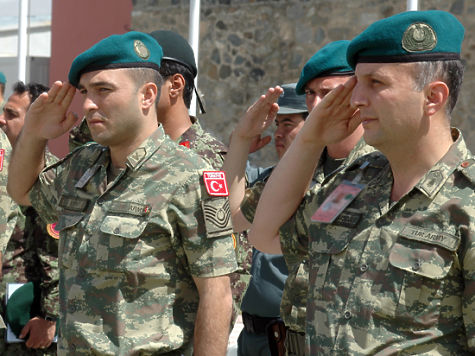 100614-N-3218H-002 (Kabul, Afghanistan) Two Turkish soldiers salute while the Afghan National Army band plays the national anthems of Turkey and Afghanistan. Turkey has an outstanding relationship with Afghanistan and continues to support recovery and sustainment. (U.S. Navy photo by MC2 (SW) Christopher Hall)